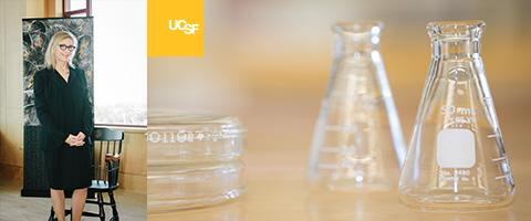 Judith Hellman photo with research lab beakers