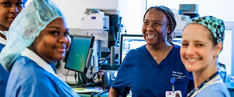 Left: Vanessa Henke, MD, with students and colleagues in the OR during UCSF SCORE 2020