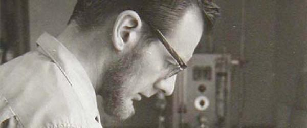 Dr. John Severinghaus looking at the first blood gas analyzer (he invented). Circa 1960.