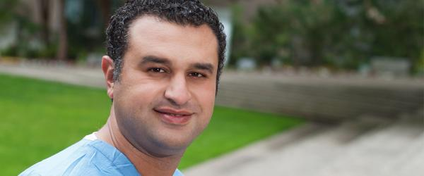 Portrait of Dr. Ahmed Shalabi in Saunder's Court on the UCSF Parnassus Campus