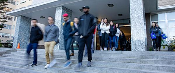 blurred photo of UCSF students exiting the Medical Sciences Building at 513 Parnassus Ave